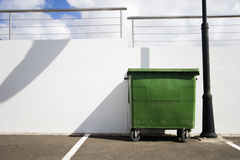 Green bin. A street scene with a green bin Stock Photography