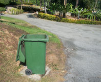 Green bin open cover outdoor in garden. With nature background Stock Photos