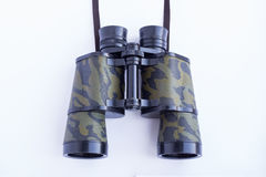 Green binoculars on a white background Stock Photo