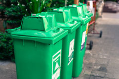 Green bins lined the park. Stock Images