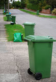 Green bins on street Stock Photography