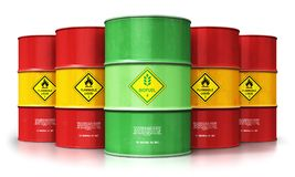 Green biofuel drum in front of red oil or gas barrels isolated o. Creative abstract ecology, alternative sustainable energy and environment protection saving Royalty Free Stock Photos