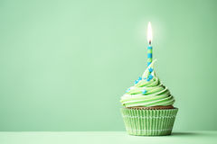 Green birthday cupcake stock images