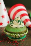 Green birthday cupcake Stock Image