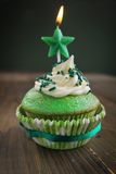 Birthday cupcake. Green birthday cupcake with star candle on top Stock Photo