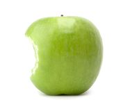 Green bitten apple. Bitten ripe apple isolated on white background stock photos