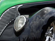 Green & Black 38 Ford. Two tone green and black 1938 Ford Hot Rod. Emphasis on grill and interesting reflections of clouds in black paint. Used existing outside royalty free stock photo