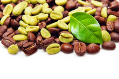 Green and black coffee beans. Stock Photo