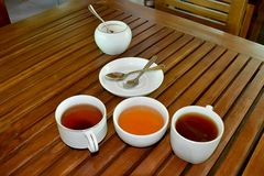 Green and black cup of tea on wood table Royalty Free Stock Photography