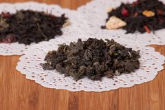 Green, Black And Fruit Loose Tea. On Wooden Table Royalty Free Stock Photography