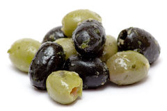 Green and Black Olives. Bunch of oily olives isolated on a white background Royalty Free Stock Images