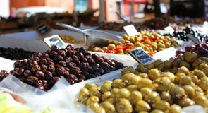 Green and black olives at a farmer market in France, Europe. Italian olive. Street French market at Nice. Fresh food by local farmers Stock Photography