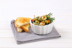 Green and black olives with garlic Royalty Free Stock Image