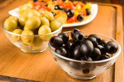 Green and black olives in glass bowl Royalty Free Stock Photo