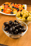 Green and black olives in glass bowl Stock Images
