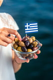Green and black olives with greek flag Royalty Free Stock Image