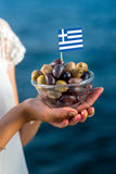 Green and black olives with greek flag Stock Photography