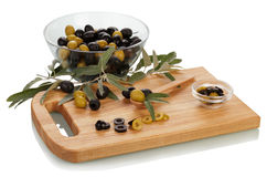 Green black olives and knife Royalty Free Stock Image