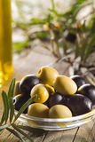 Green and black olives with leaves Stock Image