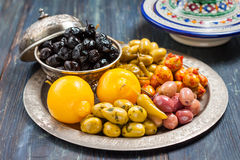 Green and black olives on a metal plate. Royalty Free Stock Images