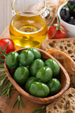 Green and black olives, olive oil and ciabatta Royalty Free Stock Photo