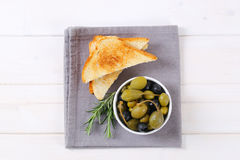 Green and black olives with toasts Royalty Free Stock Image