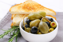 Green and black olives with toasts Royalty Free Stock Photo