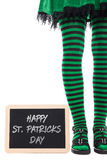 Green and black striped legs from a leprechaun girl, slate with Royalty Free Stock Images