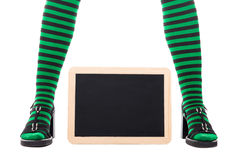 Green and black tights from a witch or goblin girl, slate with c Royalty Free Stock Photo