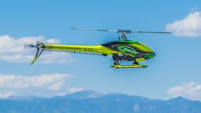 Green Black and Yellow Heli Division 630 Helicopter Royalty Free Stock Images
