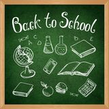 Green blackboard with chalk-drawn school objects. Vector Royalty Free Stock Photo