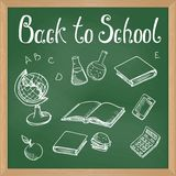 Green blackboard with chalk-drawn school objects Stock Image