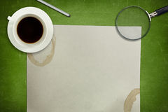 Green blackboard with coffee cup and empty paper Royalty Free Stock Photos