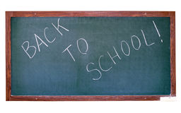 Green blackboard cutout. Green blackboard with Back To School greeting. Isolated on white Royalty Free Stock Image
