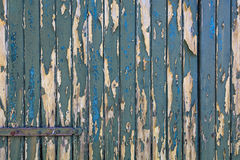 Green bladdered stable doors with rusty door fittings Royalty Free Stock Image