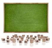 Green blank blackboard with wooden frame and block Stock Photos