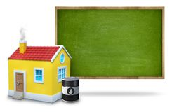 Green blank blackboard with wooden frame, 3d house. Green vintage wooden frame blank blackboard white background with 3d house and oil barrel front of blackboard stock photo