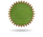 Green blank cogwheel shape blackboard with wooden Stock Photo