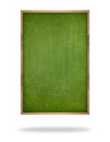 Green blank vertical blackboard with wooden frame Royalty Free Stock Images