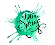 Green blob on a white background and text Hello Spring. Calligraphy lettering Stock Image