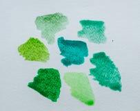 Green blobs. Blots shades of green on paper stock photos