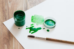 Green blobs. And a jar of gouache stock photography