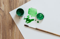 Green blobs. And a jar of gouache stock photo