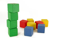 Green blocks. Green block tower standing and other colors scattered. Environmental / organic concept Royalty Free Stock Photo