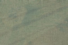 Green blotted burlap texture or background. To be used in creative designs Royalty Free Stock Photo