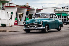 Green blue american classic car in cuba on the road Royalty Free Stock Photos