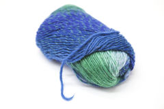 Green blue ball of wool yarn for knitting close up on a white background. Stock Images