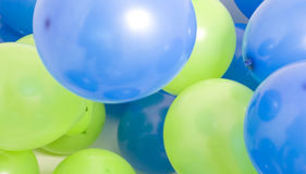 Green and Blue Balloons Background Stock Photos