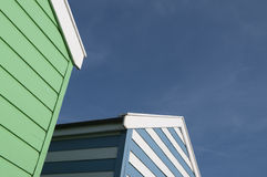 Green and blue beach huts in Suffolk UK Royalty Free Stock Photo