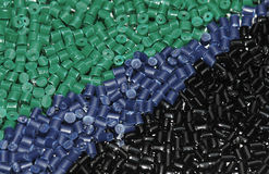 Green-blue-black Plastic granulate. Plastic granulate for injection moulding Royalty Free Stock Photo